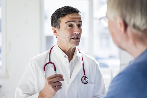 Portrait of doctor and talking to patient in medical practice - JOSF02821