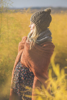 Smiling pregnant woman with closed eyes enjoying the sunshine - ASCF00921