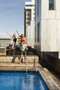 Friends having fun at a rooftop pool - VABF02119
