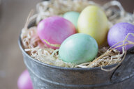 Close up of multicolor Easter eggs in bucket - HEROF04627