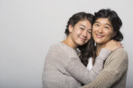 Portrait of smiling mother and daughter hugging - HEROF04753