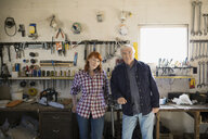 Portrait of father and daughter in workshop - HEROF04759