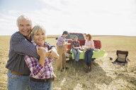 Multi-generation family enjoying lunch in crop field - HEROF04765