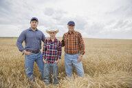 Portrait of multi-generation men in wheat field - HEROF04786