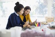Female designers working using digital tablet - HEROF04957
