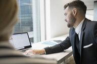 Businessman working at laptop - HEROF05038