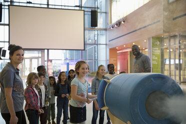 Children enjoying cloud cannon demonstration in science center - HEROF05173