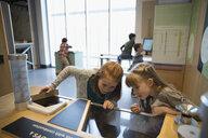Curious girls watching exhibit in science center - HEROF05185