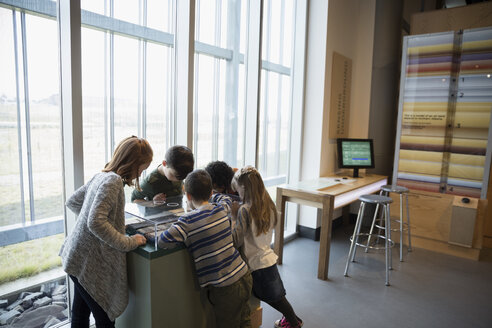 Curious children watching exhibit display in science center - HEROF05191
