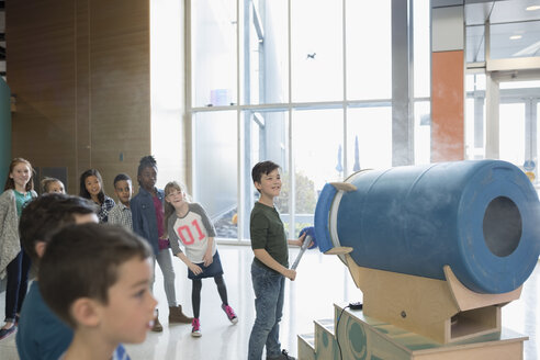 Children watching boy using cloud cannon in science center - HEROF05224
