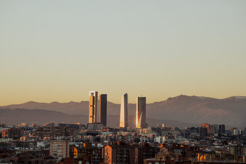 Spain, Madrid, cityscape with modern skyscrapers at twilight - JCMF00037