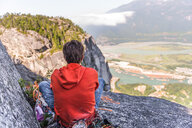Rock climber relaxing at top of rock, Squamish, Canada - CUF46938