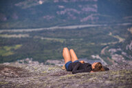 Rock climber relaxing at top of rock, Squamish, Canada - CUF46941
