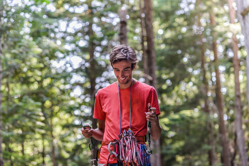 Happy rock climber in forest - CUF46944
