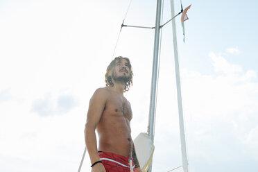 Man on sailboat - CUF46962