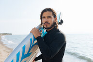 Surfer with surfboard by seaside - CUF47037