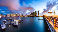 Boats moored at dock, cityscape in background, Miami, Florida, USA - CUF47043