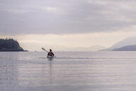 Woman kayaking in lake, Johnstone Strait, Telegraph Cove, Canada - CUF47058