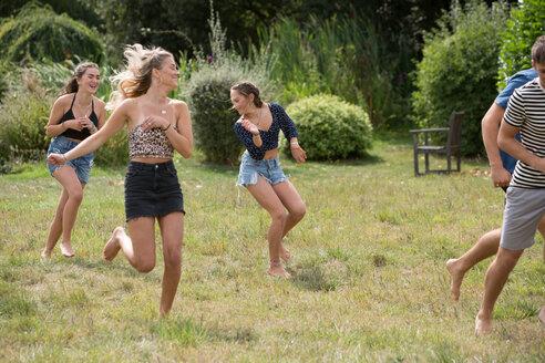 Friends running in park - CUF47172