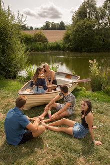 Friends relaxing by lake - CUF47175