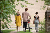 Friends taking walk with pushbike in countryside - CUF47196