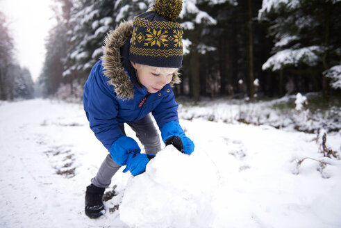 Little boy building snowman - ABIF01147