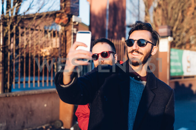 Friends taking selfie, Milan, Italy - CUF47232