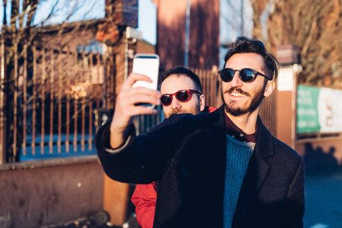Friends taking selfie, Milan, Italy - CUF47232