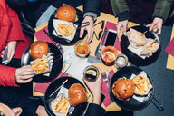 Table of burger and chips meal - CUF47244