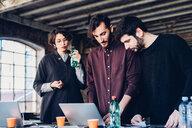 Designer showing presentation to colleagues in studio - CUF47271