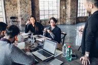 Designers having meeting in studio - CUF47280
