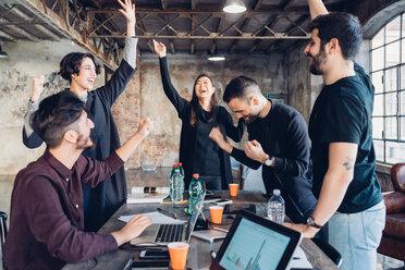 Designers celebrating success in studio - CUF47295