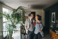 Couple in living room at home - CUF47316