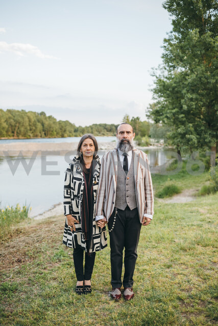 Couple standing by lake - CUF47319