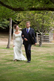 Father walking daughter to wedding - CUF47457