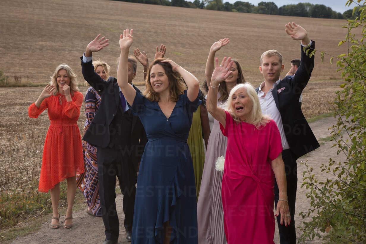 Wedding guests waving off newlyweds - CUF47463 - Jim Forrest/Westend61