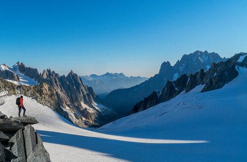 Hiker enjoying scenery, Chamonix-Mont-Blanc, Rhone-Alpes, France - CUF47484