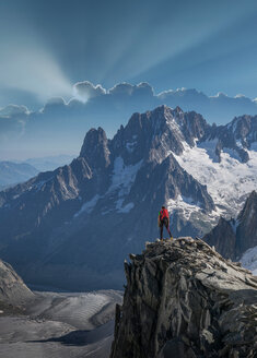 Hiker enjoying scenery, Chamonix-Mont-Blanc, Rhone-Alpes, France - CUF47487