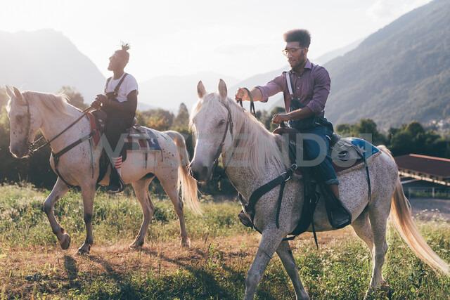 Two young men horse riding in field, Primaluna, Trentino-Alto Adige, Italy - CUF47517 - Eugenio Marongiu/Westend61