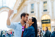 Couple taking selfie, Piazza del Duomo, Milan, Italy - CUF47619
