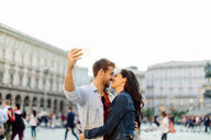 Couple taking selfie, Piazza del Duomo, Milan, Italy - CUF47622
