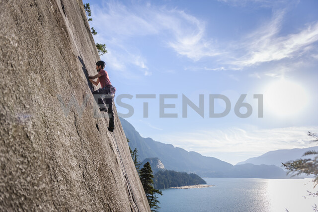 Rock climber scaling rock on Malamute, Squamish, Canada - CUF47655