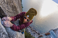 Rock climber gripping onto cracks, Malamute, Squamish, Canada - CUF47661