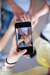 Photographing with smartphone of overlapping hands - CUF47685