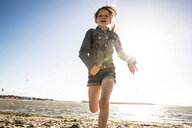 Girl running on beach - CUF47733