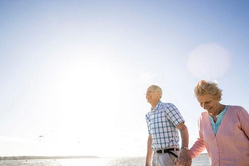 Senior adult couple enjoying beach - CUF47742