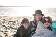 Mother with son and daughter on beach - CUF47745