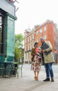 Man and woman checking cellphones, London, UK - CUF47763