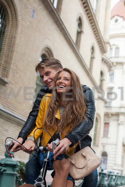 Couple on bicycle, Budapest, Hungary - CUF47766