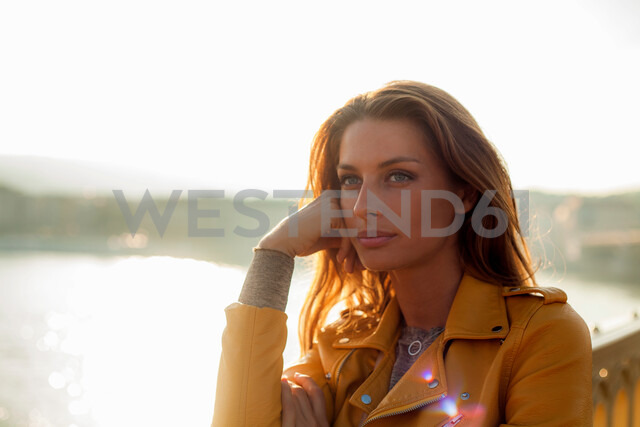 Woman with bright sunlight in background - CUF47784